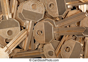 Gold-colored key blanks - Many gold-colored key blanks,...