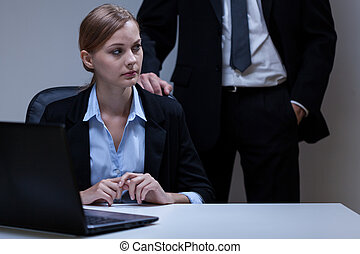 Scared woman and self-confident boss - View of scared woman...
