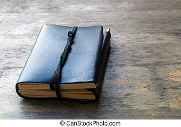 leather bound journal outdoors - A leather bound journal...