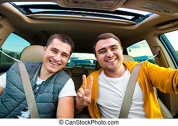 Happy friends ready for vacations driving car