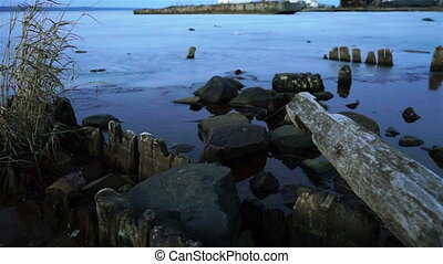Onega lake old port in winter twilight - Evening view at...