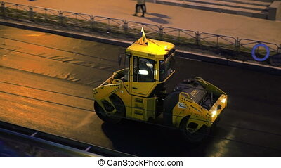 Road construction works in the evening - Asphalt laying...