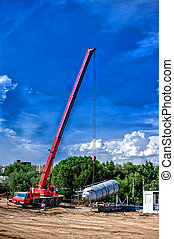 mobile industrial crane installing a concrete and cement...