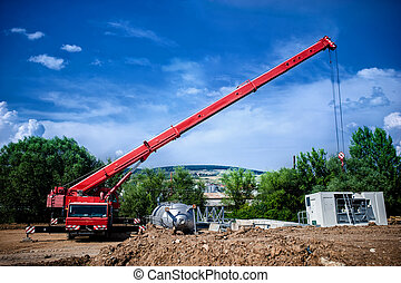 Industrial Crane operating and lifting an electric generator...