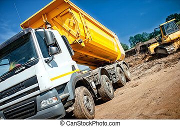 dumper truck at industrial constrution site waiting for the...