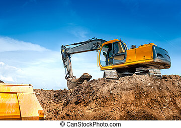 construction site digger, excavator and dumper truck. industrial