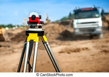 surveyor engineering equipment with theodolite at highway