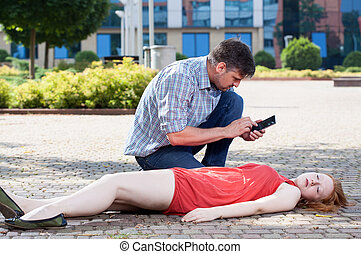 Man calling emergency service on the street