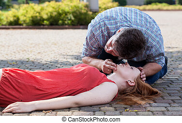 Man checking if woman's conscious - View of man checking if...