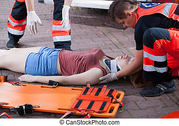 Emergency service taking woman