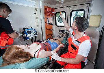 Injured woman and paramedics