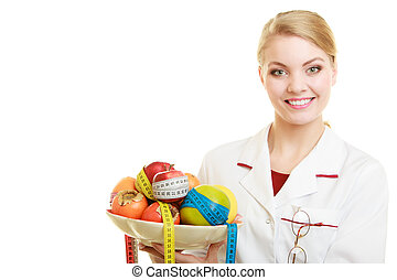 Doctor dietitian recommending healthy food. Diet. - Woman in...