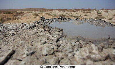 Bubbling mud volcano. Movement from left to right.