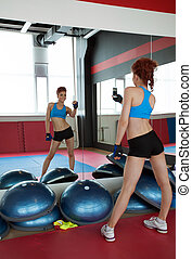 Conceited young girl doing selfie in gym - Image of...