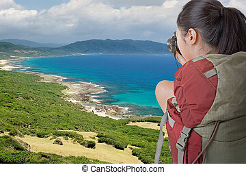 backpacker take photo - Asian female backpacker take photo...