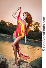 Redhead in swimsuit on the beach - Fashion portrait of young...