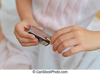 Girl playing with matches Dangerous situation at home