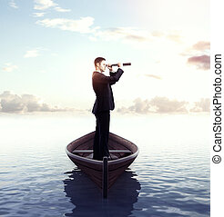 businessman with telescope - businessman looking through a...