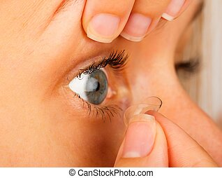 Contact Lenses Correct Removal - Close-up of woman removing...