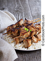 Pork kebabs in soy sauce with rice