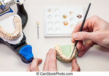 Making facial dental prosthesis on white table - Making...