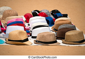 Market of Hats on Ground - Itinerant sales of hats resting...