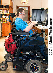 Man with infantile cerebral palsy using a computer - Man...