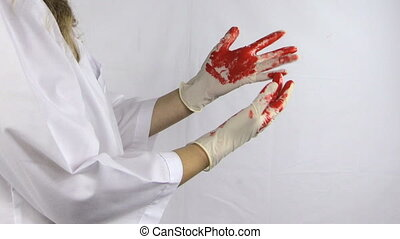 woman surgeon blood glove - Woman surgeon doctor in white...