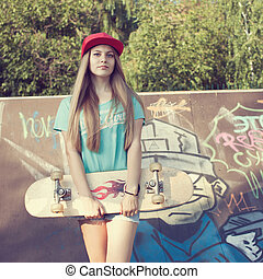 Teen girl with skateboard