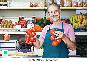 seller man in fruit market shop - adult senior sale man with...