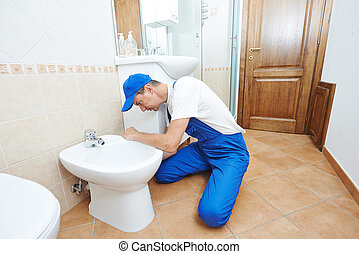 plumber man worker - plumber worker working with spanner at...