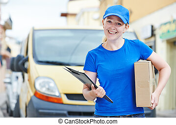 delivery woman with package outdoors - Smiling female postal...