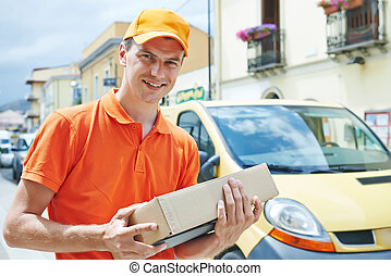 delivery man with package outdoors - Smiling male postal...
