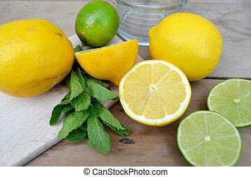 Lemons and Limes - Lemons and limes on the table