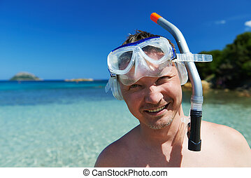 Snorkel man - smiling man in mask with tube for snorkeling...