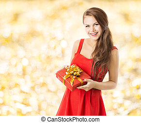 autumn present gift box, smiling woman holding presents over...