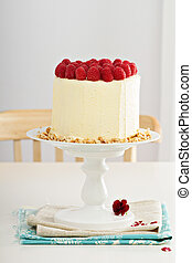 Birthday cake with cream cheese and raspberries