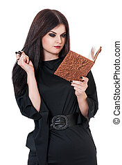 Young witch - Inquisitive witch with book for spells...