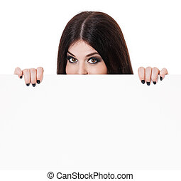 Young witch shows with blank billboard on white background