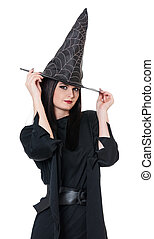 Young witch - Young beautiful witch with black hat over...