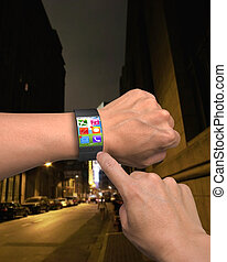 hand wearing ultra-thin curved-screen smart watch with apps...