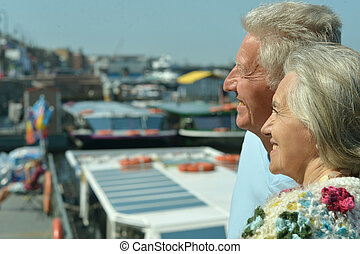 Couple on pier - Senior couple standing on pier at the...