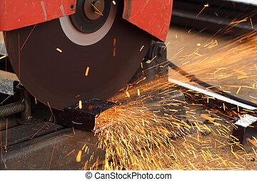 Worker cutting steel rod