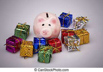 Pig money box between christmas gift on white background