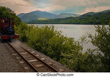 Llanberis Lake railway - Train on the tracks at the lakeside...