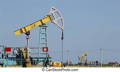 Pump Jack - working in the desert Oil Pump Jack