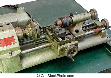 Small metal lathe isolated closeup - Small portable metal...