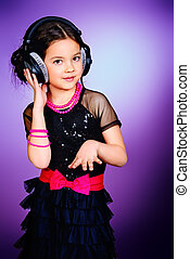 party child - Funny cheerful girl listens to music on...
