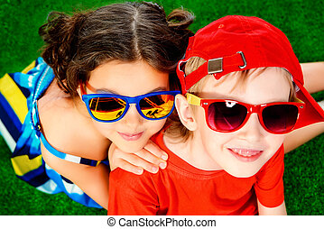 summer children - Happy smiling girl and boy in bright...
