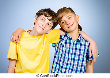 best friend - Two boys friends teenagers standing together...
